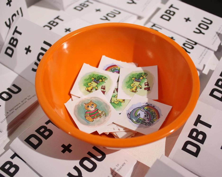 sticker bowl surrounded by mini-zines